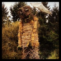 The wicker man! (Holding an umbrella in acknowledgement of England's cold and rainy 2013 spring!)