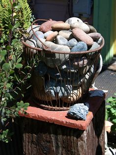 Just a basket of rocks..I'm always finding rocks I like, I'm just going to start putting them in a basket in the yard.