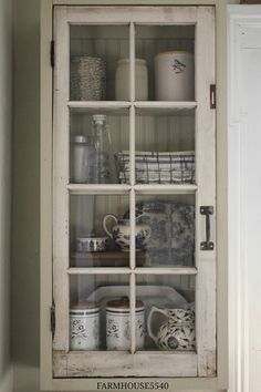 FARMHOUSE 5540: A New Cupboard With An Old Window...maybe do this on a big scale to repurpose the french doors, beadboard in back, rustic hardware...