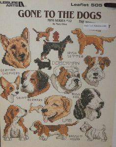 Vários cachorrinhos em ponto cruz
