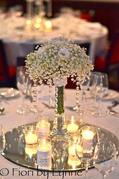 Trying to stay within your wedding planning budget? Get our best ideas for DIY wedding decorations, like centerpieces, party favors, flower arrangements, and wedding decor right here. Wedding Table Centerpieces, Flower Centerpieces, Flower Arrangements, Centerpiece Ideas, Mirror Centerpiece, Short Centerpieces, Wedding Reception Table Decorations, Table Arrangements, Wedding Tables