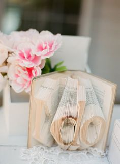 Enlist an artist's help to carve out phrases in an old book. Photo by Stephen Pappas via Style Me Pretty