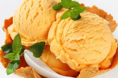 This homemade peach ice cream is the ultimate in creamy, fruity happiness. Peaches and cream are the perfect cure for those hot summer days.