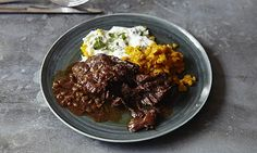 Ginger-braised ox cheeks with spiced red lentils and watercress yoghurt