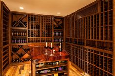 Custom Wine Cellars Massachusetts Mahogany Wine Racks in Chappo Stain with a Clear Top Coat Finish. See more elegant wine cellar wine racks at this webpage: http://www.winecellarsbycoastal.com/residential-custom-wine-cellars-orange-county-laguna-hills-fisher.aspx.Coastal Custom Wine Cellars  1117 East Putnam Avenue Riverside, CT 06878  Connecticut Office: +1 (203) 424-8663