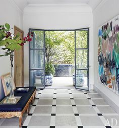 Spacious entryway - lovely flooring,  doorway; wall art makes a strong statement.