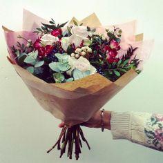 Romantic bouquet containing Roses, Brunia and Viburnum