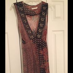 Boutique top, sheer, size L Boutique top, Size L, sheer with colors of brown and burgundy. Tops Blouses