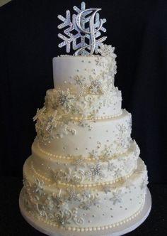 white winter wonderland wedding cakes with snowflakes