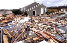 Debris floats around a house pushed off its foundation in the aftermath of superstorm Sandy in East Haven, Conn., on Oct. 30. Sandy, the storm that made landfall Monday, caused multiple fatalities, halted mass transit and cut power to more than 6 million homes and businesses. (Jessica Hill/Associated Press)