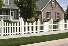 This white vinyl picket fence adds a beautiful, classic touch to any yard.