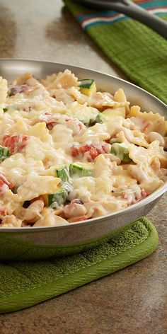 Easy vegetarian lasagna recipe with pasta, zucchini, Great Northern beans and tomatoes combined in a skillet with a creamy white sauce and cheese.