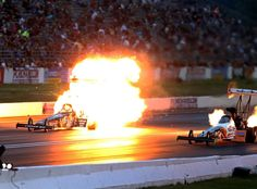 Canon 1Dx, 400mm, 5000iso, f2.8, 1/1250th, Aperture Priority NHRA top fuel dragster driver Morgan Lucas explodes an engine on fire alongside Clay Millican during qualifying for the Summernationals at Old Bridge Township Raceway Park.