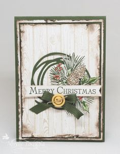I???ve used my Swirly Scribbles Thinlits to create the wreath and used a retired Stampin??? Up! Christmas stamp set called Watercolour Winter for the foliage and pine cone.