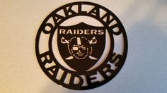 NFL Oakland Raiders Football Metal Sign, 10 inches in diameter by SPORTSMETALARTWORK on Etsy