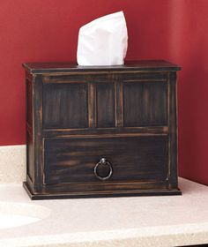 Turn your tissue into a piece of rustic decor with this Tissue Box with Storage. It holds a standard rectangular tissue box inside its chic wooden construction.