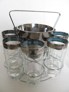 Vintage Barware Set--12 Highball Glasses, Ice Bucket and Caddy--Mad Men Barware--1950--Comes with FREE Cocktail Book. $68.00, via Etsy.