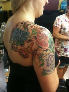 Colour tattoo covering shoulder and upper arm.
