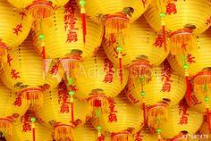 Yellow lantern handing on the ceiling .