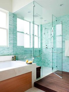 •Bold and Beautiful This frameless glass shower makes the room feel spacious. With slated ike wood, the platform outside the shower is slip-resistant and withstands constant moisture -- and is the perfect place to dry off.