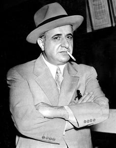 Albert Anastasia smokes a cigaret in Fort Lee, New Jersey, at police…