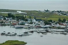 Tangier Island, Va. In the middle of the Chesapeake Bay. People still speak a unique English Restoration era dialect. Ferry access, bikes only no cars on the island and the best crab cakes in the world.