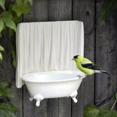 """Makes you think of """"Bird Bath"""" in a whole new way.   I've seen tub-shaped soap dishes -- used to have one from the dollar store.  Too bad I didn't think to repurpose it like this."""