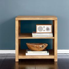 Set of side tables can stand independently or merge together in any combination you choose. Crafted of solid mango wood with a warm oak finish.