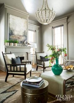 Walls & woodwork painted all in the same soft khaki color - home of designer/antiquarian Jimmy Stanton