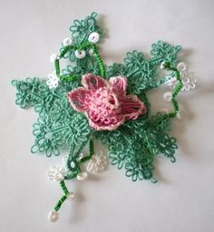Most of us remember grandmother's doilies on the arm of a chair. The lace tablecloths and bureau scarves and handkerchiefs were as comforting to us as the smell of apple pie cooling in the kitchen. Lace is now old-fashioned, those old doilies now...