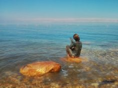 a girl covered with the mud of the Dead Sea ~Photo by Tahira