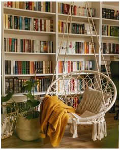 Love this mini home library with a simple hanging chair as a seating spot to get the maximum wall space for bookshelves as a reading room interior idea. Home Libraries, Stylish Home Decor, Bohemian Decor, Bohemian Interior, Home Furniture, Furniture Legs, Barbie Furniture, Garden Furniture, Furniture Design