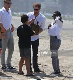 Prince Harry watches Surfers Not Street Children participants demonstrate surf skills at the beach as part of his visit to South Africa on December 1, 2015 in Durban, South Africa.