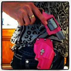 JuJu and her Charter Arms 'Pink Lady' and matching holster. 38 special handgun. Pink gun