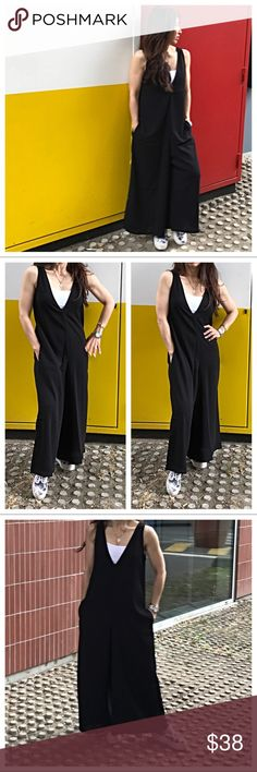 🆕 Paris black jumpsuit Wide leg loose fit side pockets wide leg ankle length V neck jumpsuit this is fabulous in a rayon crepe fabric style is unique and chic PLEASE Use the Poshmark new option you can purchase and it will give you the option to pick the size you want ( all sizes are available) BUNDLE and save 10% ( no trades price is firm unless bundled) Paris Boutique Pants Jumpsuits & Rompers