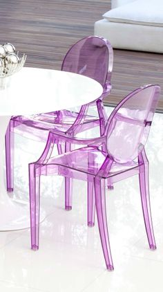 Purple transparent dining chairs // based on a Philipe Starck design... LOVE.