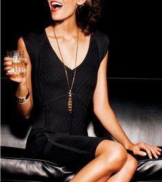 black dress, matching jewelry gold