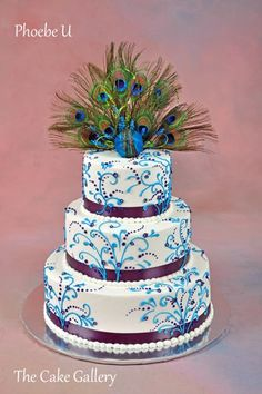Wedding Cake Photos | The Cake Gallery Omaha. white with blue and purple and peacock feathers