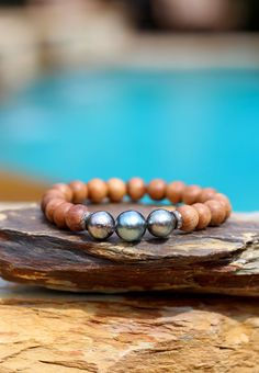 **This listing is for ONLY the 3 Tahitian Pearls on Sandalwood with two Pave Diamond Roundels stretch bracelet. Organic and chic; this heavenly-scented 9mm Indian sandalwood stretch bracelet features three genuine baroque Tahitian pearls in a row, flanked on either end by a sterling silver genuine pave diamond roundel. GORGEOUS neutral - a fun addition to your favorite stack of bracelets. This one should be a favorite year round. Beautiful materials at a great price. :))   ***This listing is…