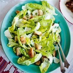 Green salad with a walnut and lemon dressing recipe. This fresh, nutty salad goes well with a spread on Boxing Day or makes a classy side salad as part of a dinner party menu.
