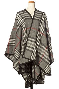 Timeless plaid cape is perfect to sport on those days when there is a chill in the air. Classic and stylish with leggings or jeans. This will never go out of style! Wrap yourself in its warmth and bea