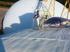 TMI high pressure washing to clean the exterior of a concrete processing dome in MN.