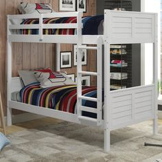 $430; Playful and posh, this beautiful bunk bed is the perfect pick for your little one's room. Keep it centered on a blank wall with framed movie posters on either side for a distinctive display, then use the spared space in the center to roll out a stylish striped rug topped with poufs and keep a bench nearby to stage a small TV and a stack of DVDs. Whether they're kicking back with a flick before bed or hosting a sleepover with a group of friends, it's sure to be a hit. Outfit both b...