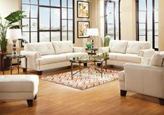It's not the best furniture, but it's easy clean and goes with everything. Ignore the rug: Cindy Crawford Home   Smoke Leather Eden Place   5 Pc Living Room