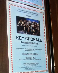 Promotional poster for Sarasota's Key Chorale performance in Carnegie Hall in Dunfermline, Scotland in 2012.  The poster was next to one for a Bon Jovi concert at the hall. The Key Chorale concert was presented by Dunfermline Sister Cities to recognize the 10th anniversary of the city's twinning with Sarasota in 2002