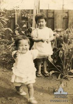 Probably c.1943. One of a set of photographs probably taken from a Japanese soldier after the Allied landing at Balikpapan 1945-07. Two young unidentified Japanese children.