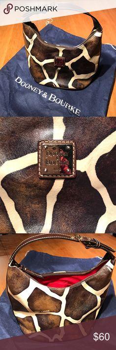 Dooney & Bourke Leather Giraffe Bucket Handbag 100% genuine leather bucket bag with cream & brown giraffe print with red inside -- like new -- comes with protective bag Dooney & Bourke Bags