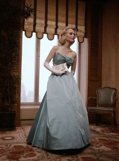 This is a formal dress made of Eastman Estron acetate in 1960.
