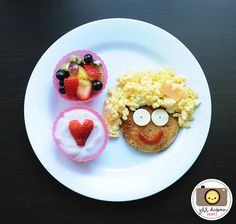 breakfast lady  . . . buttered toast cut in a circle, scrambled eggs for the hair.  too fun!