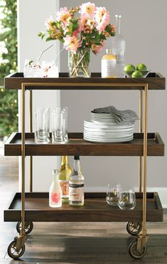 Catch this trolley: our Oak Park Bar Cart. It has three tray-style service shelves for cocktails, food, everything you need for entertaining.